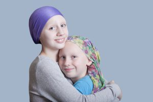 Girls-with-Cancer-Hug-Close-Up-000023255590_Large